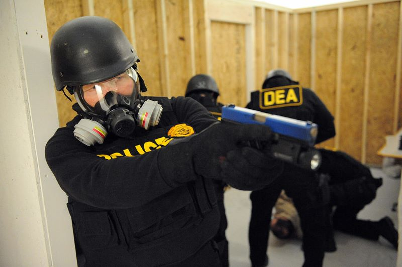 DEA agent in training with gun.