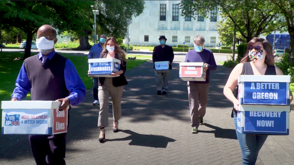 Measure 110 Campaign volunteers deliver boxes containing signed petitions in favor of the measure to the Oregon Secretary of State's office in Salem on June 26, 2020.